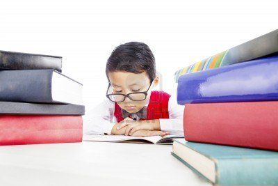 14779037-portrait-of-asian-elementary-school-student-reads-books-seriously-to-prepare-his-test.jpg